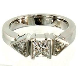 Princess cut With 2 Trilliant cut Diamonds